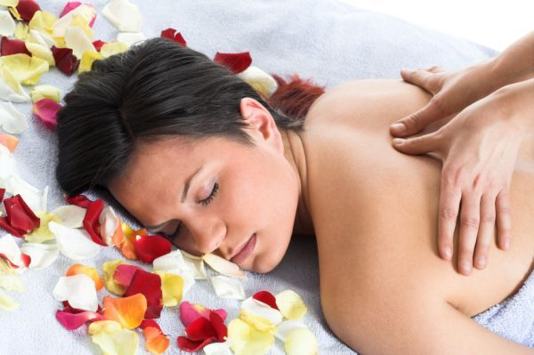 Woman getting a back massage in front of the white background